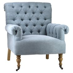 Rolled arm chair with diamond-tufted upholstery and an oak wood frame.   Product: Arm chairConstruction Material: