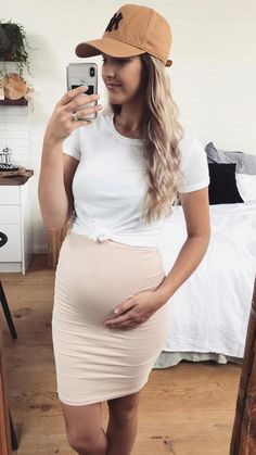 Our super, soft Over the Belly Skirt is the maternity pencil skirt of your dreams! All Sexy Mama Maternity skirts pull over your baby bump to provide ultimate maternity comfort and plenty of room to grow. #maternityootd #maternityskirt #27weeks