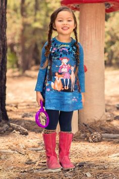 Fawn and fox coexist peacefully with a girl holding a bunny on this tranquil girls' forest-print dress, with a serene blue background and a relaxed zen vibe that will bring some centered calm to her hectic school days and ground her in nature.Dress is made of a comfortable jersey knit fabric Washes and wears well for play and schoolDesigned by Room Seven