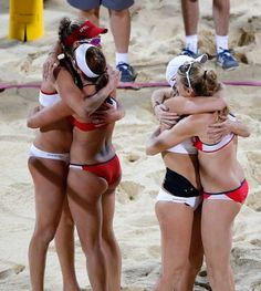 Kerri Walsh Jennings and Misty May-Treanor hug April Ross and Jennifer Kessy after a women's gold medal beach volleyball match. Team USA!