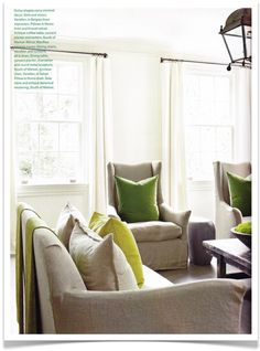 Oh, those amazing green pillows!! And the linen chairs with the tiny swoopy arms!!