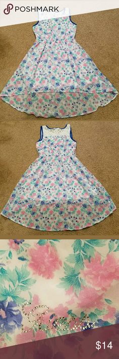 Guess Kids Girl's Floral Hi Low Dress Size 14 This is a really great gently pre-owned Guess Kids Girl's Floral Hi Low Dress Size 14. It is in excellent pre-owned condition.  It is missing the fashion belt that came with it. It is a blue and pink sheer floral dress with lace at the shoulders and a white slip underneath. It is high in the front hitting atbor above the knee and low in the back. Measurements are: Armpit to Armpit: 16 nches  Waist: 13 inches unstretched stretches to 16 inches…