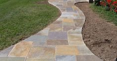 """Pathways are not just a way to add functionality to your outdoor space--they also add variety and charm. Check out this list for examples of different mediums and styles you can use for your pathway. This could be a great weekend DIY project! #1 Log """"slice"""" pathway... #backyard #boardwalk #brick"""