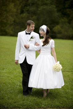 Love the short wedding dress and the grooms white jacket.