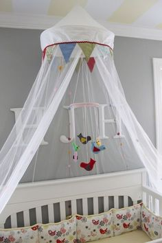 circus tent crib.  already brought materials to make this.  gonna look a little different, because I thought of it before I found this pic.  mine's going to RULE