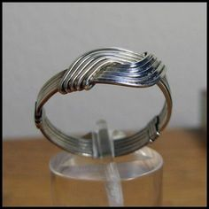Wire wrapped rings 322570392057944292 - Love Knot Ring – Unisex – Sterling Silver Wire Wrapped Source by palisseau Wire Jewelry Rings, Wire Jewelry Designs, Beaded Rings, Copper Jewelry, Jewellery Box, Jewlery, Wire Bracelets, Jewellery Shops, Jewelry Holder