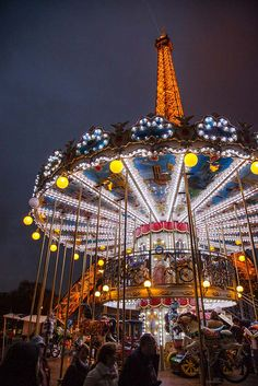 The Eiffel Tower looms over a carousel in the heart of Paris, France