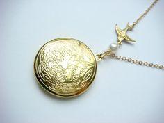 Peeta Locket Necklace - Gold Mockingjay Hunger Games Locket Necklace With Pearl - Vintage Inspired - Flying Bird. $26.00, via Etsy.