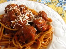 Baked Spaghetti and Meatballs Recipe 1 tablespoon olive oil 1 onion, chopped 1 (16-ounce) package frozen precooked meatballs 1 (26-ounce) jar spaghetti sauce 1/2 cup water 1 pound spaghetti pasta 1/3 cup grated Parmesan cheese