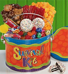 The Popcorn Factory® Survival Kit Treats Pail.    Sometimes you just need snacks in order to get through the day. Dig into this 1/2 gallon Survival Treat Pail from The Popcorn Factory® that's filled with both Cheese and Chocolate popcorn, Jelly Belly® Fruit Snacks, red licorice, 2 rainbow sandwich cookies, chocolates and Kiddy Mix candies.