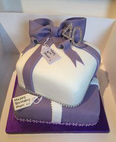 Purple And White present stack birthday cake