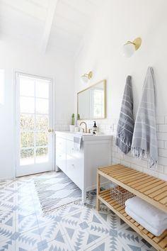 patterned bathroom floor tile w/ ikea vanity   gold wall sconces