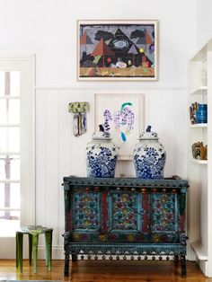 Love this eclectic quirky fun space with that modern abstract art and the painted sideboard.