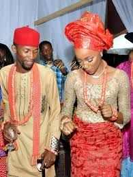 Igbo bride and groom dancing at their traditional wedding ceremony