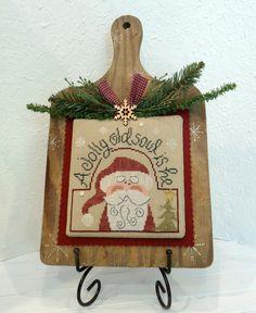Santa cross stitch/A jolly old soul is he. Custom finish on antique breadboard.