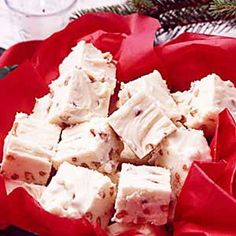 White Chocolate Fudge - Ingredients 1 package (8 ounces) cream cheese, softened 4 cups confectioners' sugar 1-1/2 teaspoons vanilla extract 12 ounces white baking chocolate 3/4 cup chopped pecans