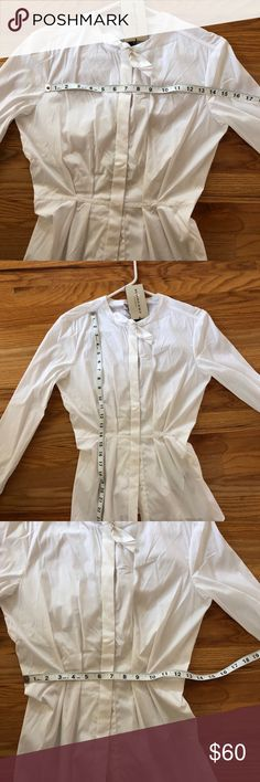 ❤️ Burberry London Dres Shirt ❤️ Gorgeous NWT Burberry London Button Up Dress Shirt - I've had this beauty in my closet for awhile; therefore, there is some yellowing at the bottom of the Shirt - however, this can easily be taken out by a dry cleaner!! The yellowing is reflected in the price, 100% Authentic Burberry London or your money back.. will make an amazing Christmas gift 💝 Burberry Tops Blouses