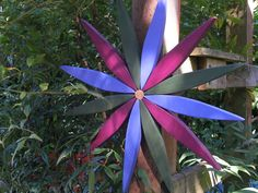 For your outdoor and indoor decorating this year consider my colorful wooden folk art style starburst wreath made from reclaimed pine.  The