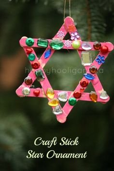 An adorable craft stick star ornament for toddlers to make.  Perfect for a last minute Christmas craft for kids - happy hooligans