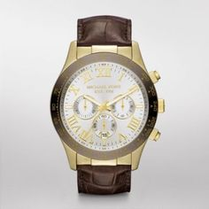 Layton Gold Tone Chronograph Watch  This Michael Kors timepiece features an espresso topring and silver-tone dial. A croco-embossed strap completes the look.