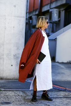 Oversized is an understatement with this varsity-inspired jacket. #refinery29 http://www.refinery29.com/2016/05/111596/sydney-fashion-week-resort-2016-street-style-pictures#slide-28