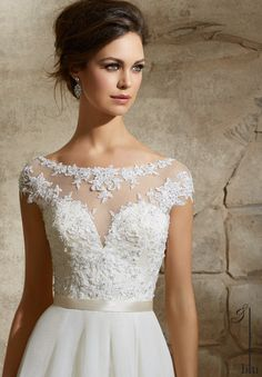 Sheer sleeves are in and looking fabulous! Like this Mori Lee Style 5362