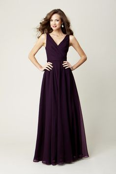A long, chiffon bridesmaid dress in eggplant is perfect for a winter-themed wedding. | A Romantic Winter-Themed Wedding