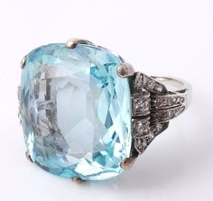 Beautiful aquamarine and diamond ring, rectangular cushion cut aquamarine, aprox 20 carats. Sold for £2,728 at Dreweatts & Bloomsbury Auctions' Fine Jewellery Sale 27 November 21014