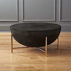 Designed by Mermelada Estudio, handmade coffee table resounds with global style. Inspired by North African drums, substantial surface combines cement, stone powder, granite and marble powder to a natural stone effect. Round Black Coffee Table, Coffee Table Design, Modern Coffee Tables, Coffee Mugs, Living Room Furniture, Modern Furniture, Furniture Design, Office Furniture, Centerpieces