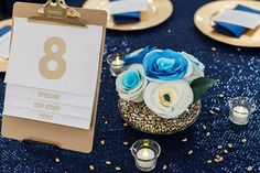 modern table number attached to clipboard with menu and reception program