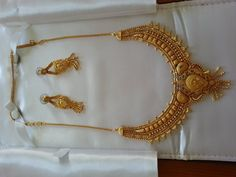 This set of jewelry is from India and very nice! It is made out of a  metallic grain mixed with gold. It was 520 $ new and we are selling it for 250 $ or best offer. If you have any questions please E-Mail Klara at number1deputydog@hotmail.com Thank you
