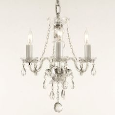 This is a 100-percent crystal chandelier that reflects the light of the candle bulbs, each resting in a scalloped bobache. The crystal glass arms of this wonderful chandelier give it a look of timeless elegance.