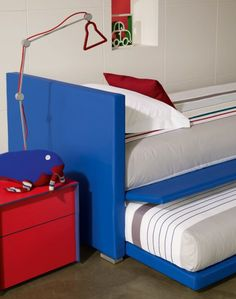 """It's the weekend! Time for a sleepover! [""""Biss"""" by Flou. Trundle Bed with removable cover. Design by Pinuccio Borgonovo. Various fabric options available] #Bedroom #InteriorDesign #HomeDecor #Design #Arredamento #Furnishings #red #blue"""