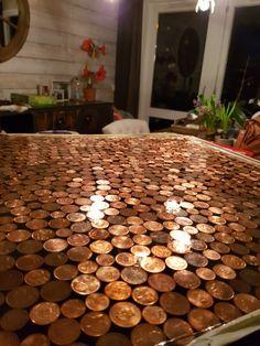 Tafelblad van centen in de epoxy