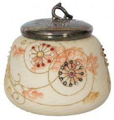 Mt. Washington Crown Milano Jar. Satin opaque glass jar with a swirling ribbed design, enamel decorated with orange and gold swirling leaves and colorful beaded embellishments