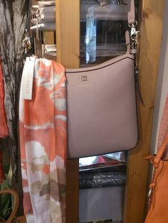 Coral scarf and coccinelle bag at Jasmine