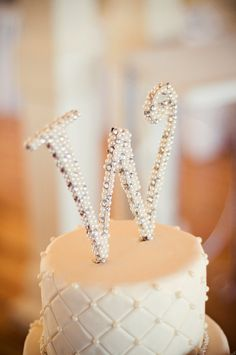 Check out this beautiful monogram cake topper covered in pearls and rhinestones. $75.00 custom made on Etsy!