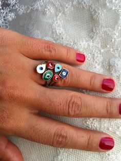 Evil eye ring. Gah I want this! It's just not in my size.