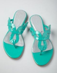 I've got a serious hankering for turquoise shoes. These slides look awfully cheery. Mui likey. by graciela