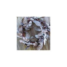 A Brown and silver artificial wreath of berries, leaves and twigs found on Polyvore