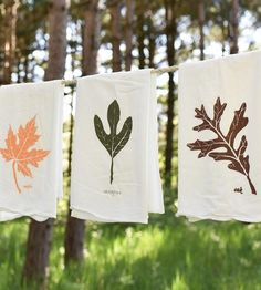Add these autumn leaf kitchen towels to your space for a seasonal décor update. Printed by hand on flour sack cotton, each tea towel features a different leaf found underfoot: an orange maple leaf, a forest green sassafras leaf and a brown oak leaf.