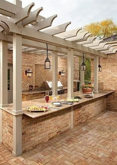 Outdoor kitchen with pergola and lantern lighting. #outdoorkitchen #outdoorliving homechanneltv.com