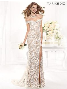 Made of sheer lace and you, this elegantly sexy Tarik Ediz 92388 evening dress is something truly special. This off the shoulder fit and flare gown is made entirely of floral lace, fully lined in nude fabric for an alluring look.