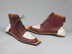 John Galliano's 'Fallen Angels'- Pair of leather and canvas shoes  with extended soles, designed by Patrick Cox for John Galliano's 'Fallen Angels', Great Britain, 1985. Given by the designer