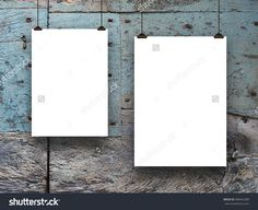 #Two #blank #frames against #blue #grey #weathered #wooden #background