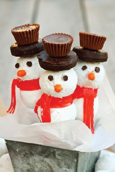 These fun Donut Hole Snowmen are irresistibly cute and so fun to put together with the whole family. With a stick to hold on to, they're the perfect party dessert and a great kid-friendly edible craft for snow days.