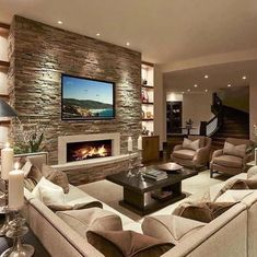 Modern Living room with Cream sofa. designs modern living room 15 Luxury Homes with Pool - Millionaire Lifestyle - Dream Home - Gazzed Living Room Tv Unit, Living Room With Fireplace, Living Room Modern, Living Room Interior, Home Living Room, Living Room Designs, Cozy Living, Small Living, Fireplace Design