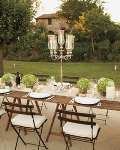 Hydrangeas and tall silver candelabras add elegance to a rustic reception table