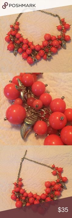 """Nautical Coral Bubble Necklace A super cute and preppy nautical themed necklace! The charms are starfish and seashells, and the beads are coral colored. Measures 19"""" in length with a lobster claw clasp and options to wear it shorter or longer. In great condition! Jewelry Necklaces"""