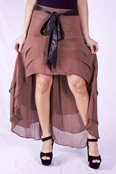 Asymmetrical skirt features overlapping layers of soft chiffon that form a high-low hem and enhanced with a faux leather black bow at the waistline. $51.00